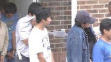 IMAGE: Suspected Illegal Immigrants Prepare For Deportation Hearing