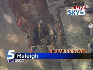 workers in hole gas leak