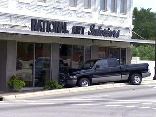 truck smashes into business