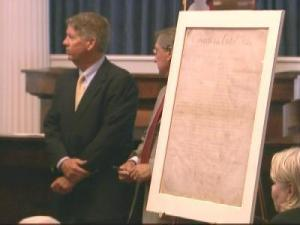 State officials accept North Carolina's original copy of the Bill of Rights in a 2005 ceremony at the State Capitol.