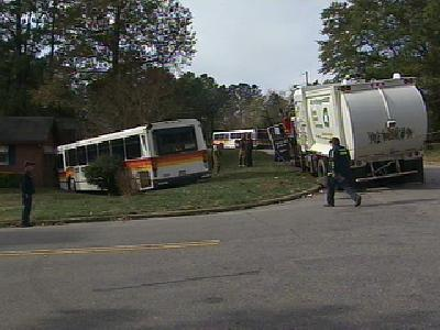 cat bus garbage truck collide