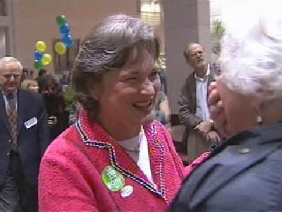 Wake County Board of Education Chairwoman Patti Head talks with supporters of the school system's $970 million school bond on election night.