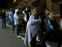 Holiday shoppers wait in long lines and brave cold temperatures for Black Friday sales.