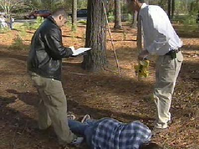 Wake Tech criminal justice students take part in a role-playing exercise of a gang shootout.