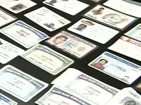 Authorities show a number of fake ID cards and Social Security cards that they believe were created at a house in Raeford.