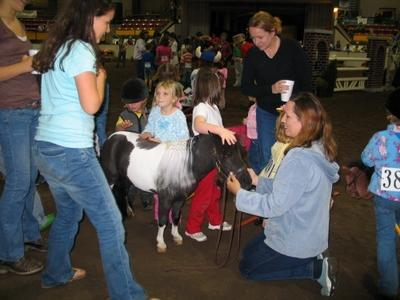 <I>Image from Mary & Tara Needham</I> <BR /><BR />Duke Children's Hospital Benefit Horse Show Family Fun Night. Leo the Miniature Therapy Horse from Stampede Of Love visits with the children. Nov. 10, 2006