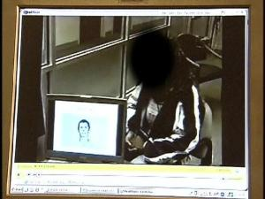 The woman who says she was raped by three Duke University lacrosse athletes is shown a photo of Collin Finnerty during a questionable photographic lineup at the Durham Police Department on April 4.