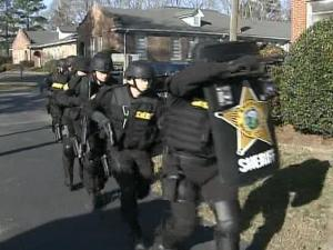 Training in research and tactics are what police SWAT teams depend on to help them assure everyone's safety during raids.