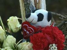 Flowers and a stuffed bear mark the site where Sadiki Ayize Young, 18, was killed in an early-Sunday morning car accident.
