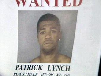 A flier shows the name and photo of fugitive Patrick Lynch.