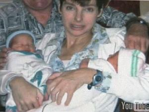 Allison Quets is shown holding twins Tyler and Holly shortly after their birth.