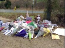A makeshift memorial marks the spot where a Wakefield High School student died in a car crash two weeks ago.