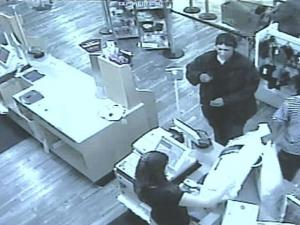 Suspects sought by Apex police were captured on a surveillance camera using a credit card that police said was stolen.