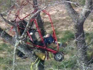 A pilot found himself stuck in a tree after his plane crashed in Moore County.