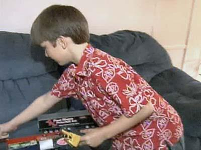 Lawrence Martin, 8, is still recovering from a vicious dog attack in the yard of a nearby home.