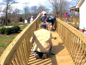 Family, friends, and even strangers were hard at work on Ted Smith's home Saturday, building a wheelchair ramp.