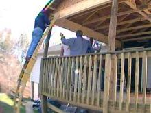Volunteers built a new porch for Ted Smith, who recently was paralyzed during a freak accident.