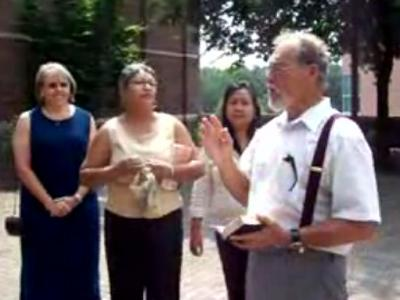 """""""The Pit Preacher"""" Gary Birdsong talks with students at the University of North Carolina at Chapel Hill. Campus police say they banned Birdsong from campus after an incident at the popular campus gathering spot."""
