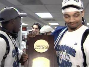 Barton guard Anthony Atkinson (left) showed off the NCAA Division II championship trophy after arriving at Raleigh-Durham International Airport Sunday.