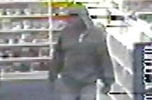 A surveillance camera captured images of a man robbing a North Raleigh video store earlier this month.