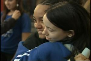 Jessica Harrison of Chapel Hill High School hugs a friend as students and chaperones arrive home at RDU from their adventure on a cruise ship that ran aground in Greece.