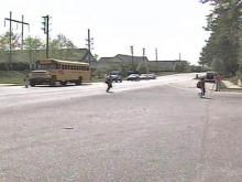 A student at Ligon Middle School was hit by a minivan while crossing Morrisville-Carpenter Road to catch her bus.