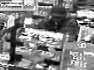 A surveillance camera catches an unknown robber at a Shell gas station in Raleigh. Police believe this man is also responsible for three other recent robberies in Raleigh (Nov. 26), Wake County (Jan. 8) and Cary (Jan 30).