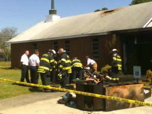 Firefighters overhaul after battling a smoke blaze that was discovered Sunday morning at Whitley Memorial United Methodist Church.