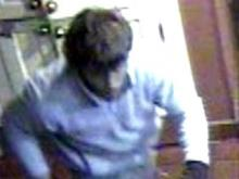 Surveillance photos show a man believed to be responsible for the theft of an ATM from a Raleigh restaurant.