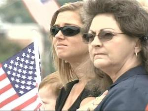 Bystanders held flags and shed tears as the funeral procession passed on Thursday, May 3, 2007.