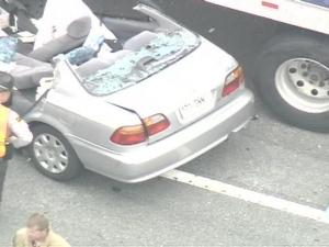 The Highway Patrol said a Canadian couple were hurt when their car was pulled under the trailer of an 18-wheeler on Interstate 95 near Benson on Thursday, May 3, 2007.