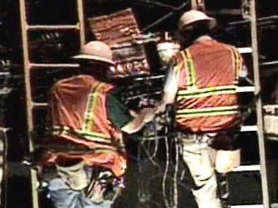 Workers splice cable to restore phone service in Clayton after an accident took out fiber-optic and conventional lines.