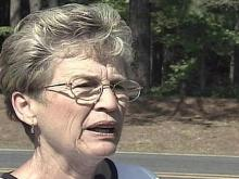 Ruth Buell said she discovered her 71-year-old neighbor and a 46-year-old woman dead inside the man's mobile home Sunday morning.
