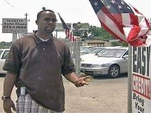City Tells Store Owners: Take Down Flags or Face Fine