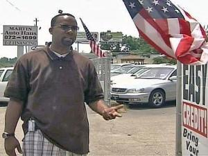 Business owner Kevin Powell said he plans to keep his flags flying.