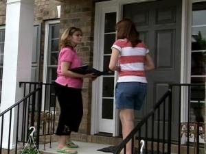 Neighbors go door-to-door Sunday collecting donations for two families who lost their homes to fire in Rolesville Friday.