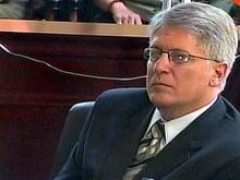 Mike Nifong listens as North Carolina State Bar Counsel Doug Brocker makes closing statements during the district attorney's ethics trial Saturday, June 16, 2007.