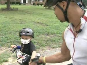 Vander Davis plans to ride his bicycle cross-country to  encourage donations for cancer research to help children like his son, Kai.