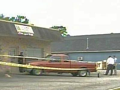 Police investigate a reported stabbing and attempted robbery at OJ TV Service on Clinton Road on July 13, 2007.