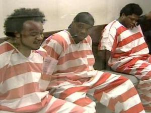 Rennaldo Luis Negron , left, and two other Wake County Jail inmates wait in court in connection with charges stemming from a disturbance at the jail on Tuesday, July 17, 2007.
