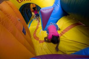 Cousins Taliya and Daysha Bunch make their way through the inflatable obstacle course.