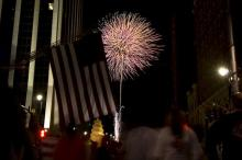 Fireworks explode over Fayetteville Street to end the day-long Raleigh Wide Open event.