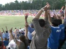 Soccer Fans Climb Trees to Catch RailHawks' Game