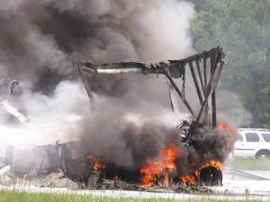 A tractor-trailer involved in an eight-vehicle accident on Interstate 40 is consumed by flames. (Courtesy Stacey Hester)
