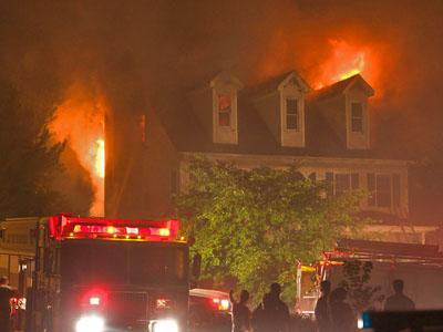 Firefighters battle a blaze at a home at 101 Lyncroft Lane in Cary around 12:30 a.m. on July 28. 2007. (Photo courtesy of John Schwaller)