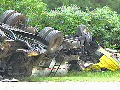 A car collided with a truck filled with hot asphalt on N.C. 210 in Johnston County on Monday, July 30, 2007, killing both drivers. A half-mile stretch of N.C. 210 at N.C. 50 near McGee's Crossroads was closed for five hours.