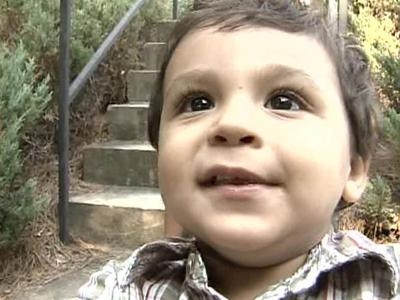Ricky Lazo looks into the camera Thursday, hours after he was reunited with his father. The 19-month-old was the focus of a statewide Amber Alert after, authorities say, his mother allegedly abducted him.
