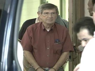 Jim Black was escorted out of the Franklin County Jail Friday. He will be taken to Lewisburg, Pa. to serve his 63-month prison sentence.