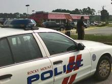 Rocky Mount police investigate after a body is found at a car dealership Monday.