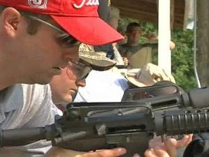Garner police officers train with semiautomatic rifles at a gun range in Cary. The Garner PD plans to have all on-duty officers carrying semiautomatic weapons.